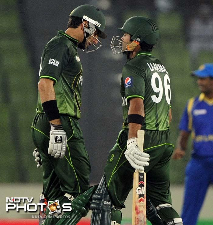 Mohammad Hafeez (11) also fell early which brought Misbah-ul-Haq (L) and Umar Akmal to the crease.