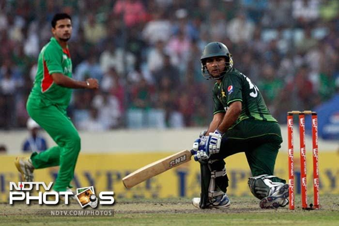 Bangladesh's Masrafe bin Mortaza, left, eyes the ball after a shot by Pakistan's Sarfraz Ahmed during their Asia Cup cricket match final in Dhaka.