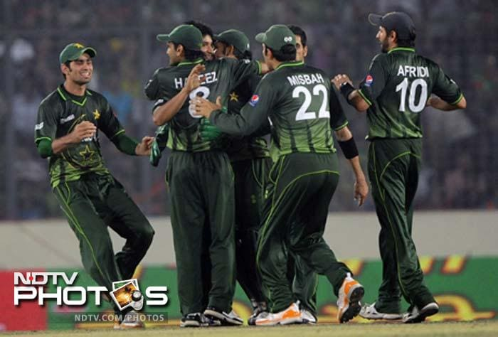 Pakistan's cricketers celebrate after the dismissal of the unseen Bangladeshi batsman Shakib Al Hasan during the one day international (ODI) Asia Cup cricket final match between Bangladesh and Pakistan.