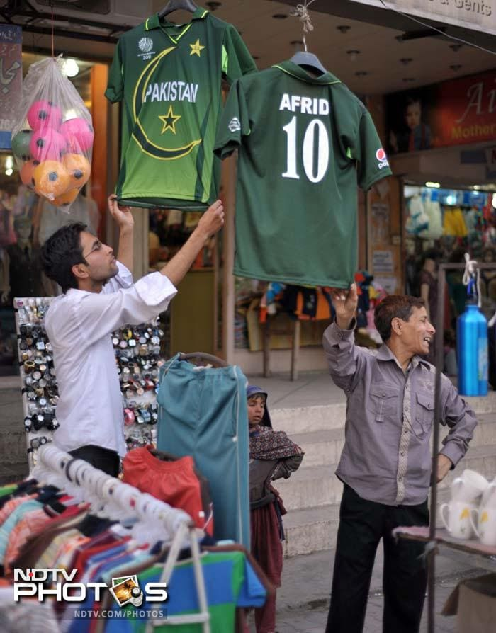 Pakistani vendors sell cricket team jerseys in Rawalpindi on March 22, 2012 during the final match between Pakistan and Bangladesh.