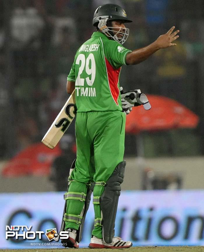 Bangladeshi batsman Tamim Iqbal gestures after scoring his fourth successive half century during the one day international (ODI) Asia Cup cricket final match between Bangladesh and Pakistan at The Sher-e-Bangla National Cricket Stadium in Dhaka.
