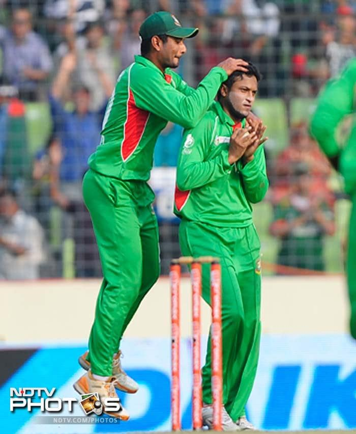 Bangladeshi cricketer Mohammad Mahmudullah (L) congratulates his teammate Shakib Al Hasan (R) after the dismissal of Pakistan batsman Hammad Azam during the one day international (ODI) Asia Cup cricket final match between Bangladesh and Pakistan.