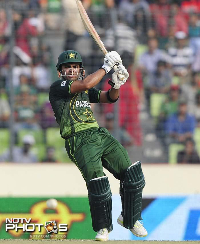 Pakistan's batsman Umar Akmal plays a shot during the one day international (ODI) Asia Cup cricket final match between Bangladesh and Pakistan at The Sher-e-Bangla National Cricket Stadium in Dhaka.