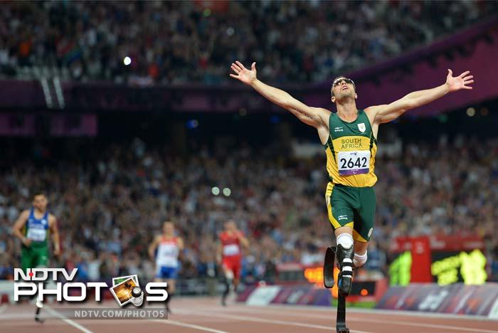 South Africa's Oscar Pistorius crosses the line to win gold in the men's 400m - T44 final.