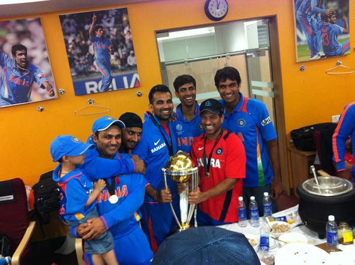 Sachin, Bhajji, Zaheer, Nehra, Munaf and Viru pose with the World Cup trophy inside the dressing room.