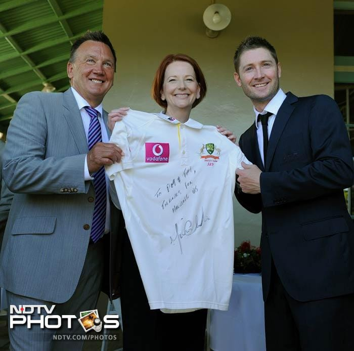 Australian skipper Michael Clarke presented his jersey to PM Gillard while Dhoni promised a mouthwatering India-Australia contest. (AFP Photo)