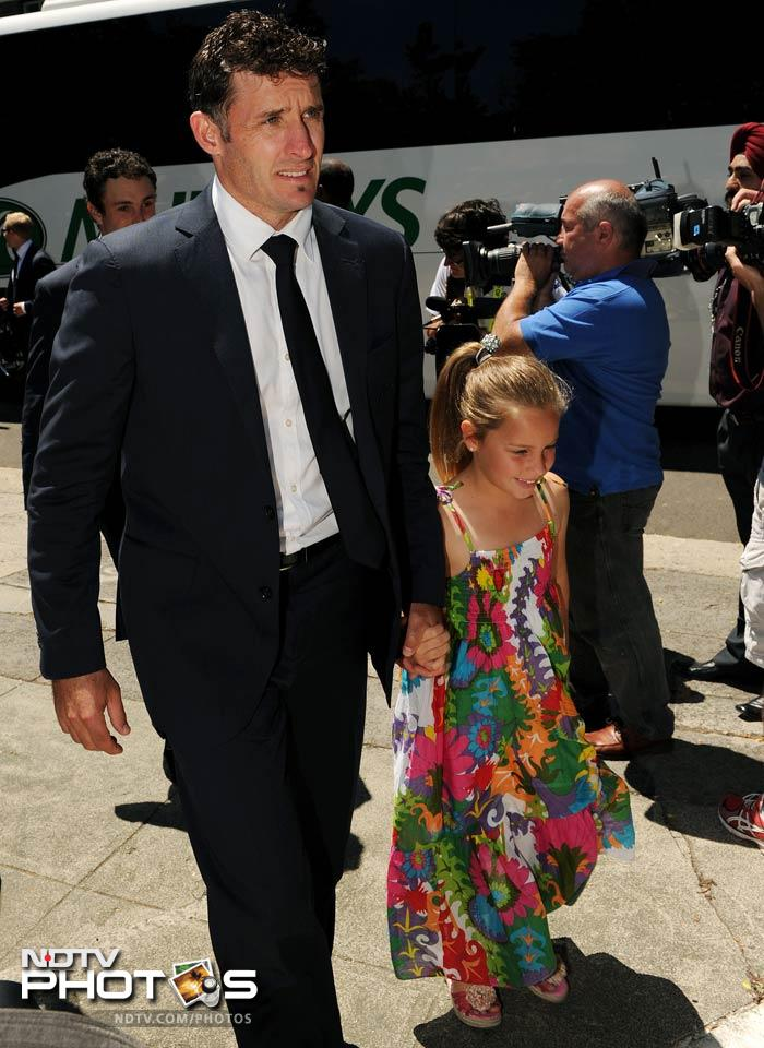 Australian cricketer Michael Hussey arrives with his daughter Jasmine for the afternoon tea. (AFP Photo)