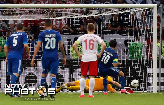 Substitute goalkeeper Przemyslaw Tyton was the unlikely hero as his penalty save from Greek captain Giorgos Karagounis saw Euro 2012 co-hosts Poland draw 1-1 with Greece in an incident-packed opening match on Friday. (All AFP and AP Images)