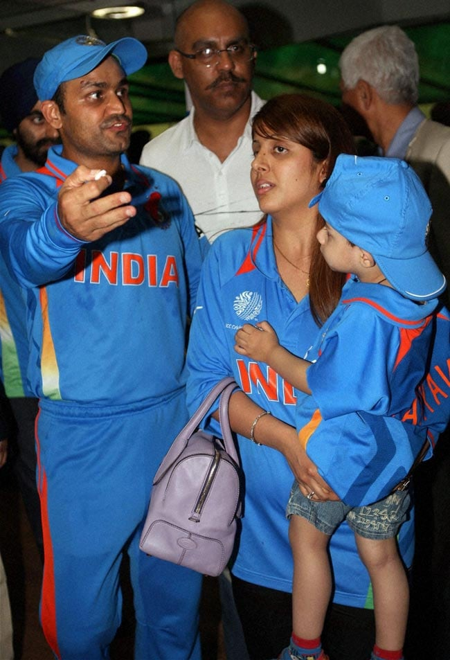 Virender Sehwag with wife Aarti and son Aryavir after the team's win over Pakistan in the World Cup 2011 semifinal match at the PCA stadium, Mohali on Wednesday night. (Photo: PTI)