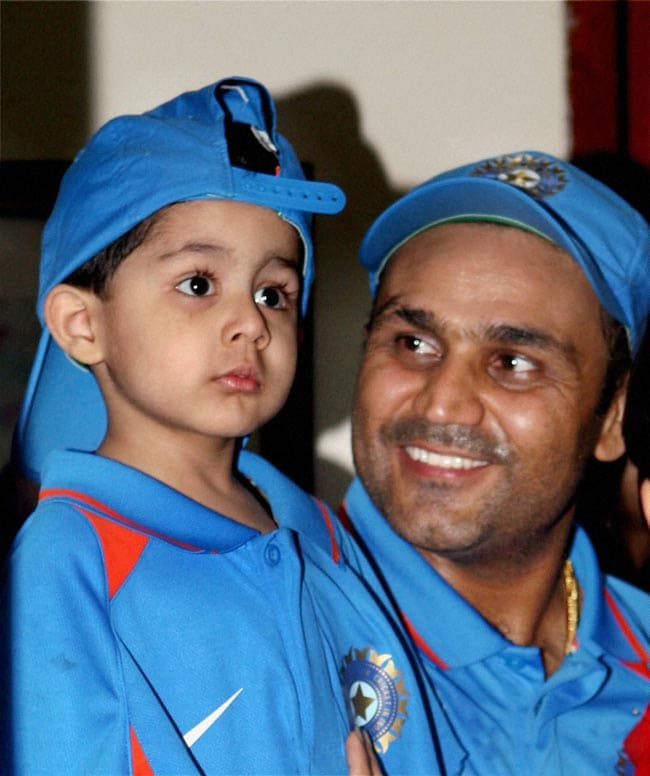 Sehwag is fascinated by his little guy. Isn't he the cutest thing ever? (Photo: PTI)