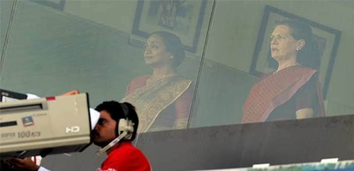 United Progress Alliance (UPA) Chairperson Sonia Gandhi (R) and Lok Sabha Speaker Meera Kumar (L) observe the national anthem from the stands prior to the start of the ICC cricket World Cup semi final match between India and Pakistan at the Punjab Cricket Association (PCA) stadium in Mohali. (AFP Photo)