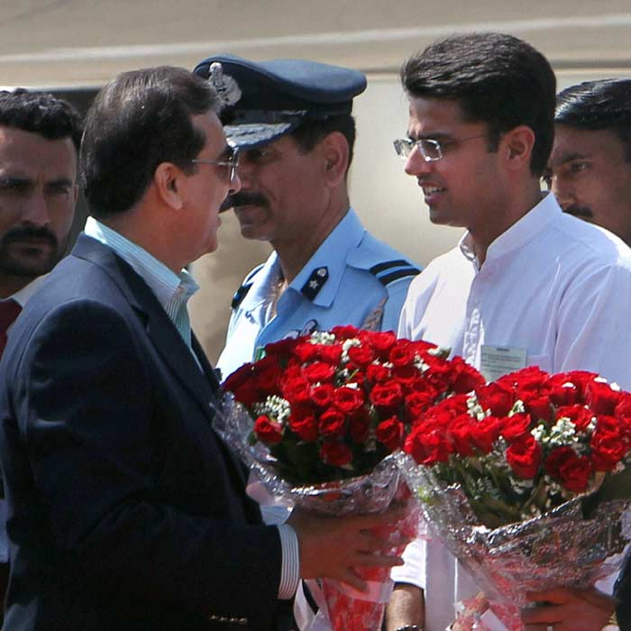Pakistani Prime Minister Yousuf Raza Gilani being welcomed by MoS for Communications & IT Sachin Pilot after his arrival at Chandigarh Technical Airport on Wednesday. (PTI Photo)
