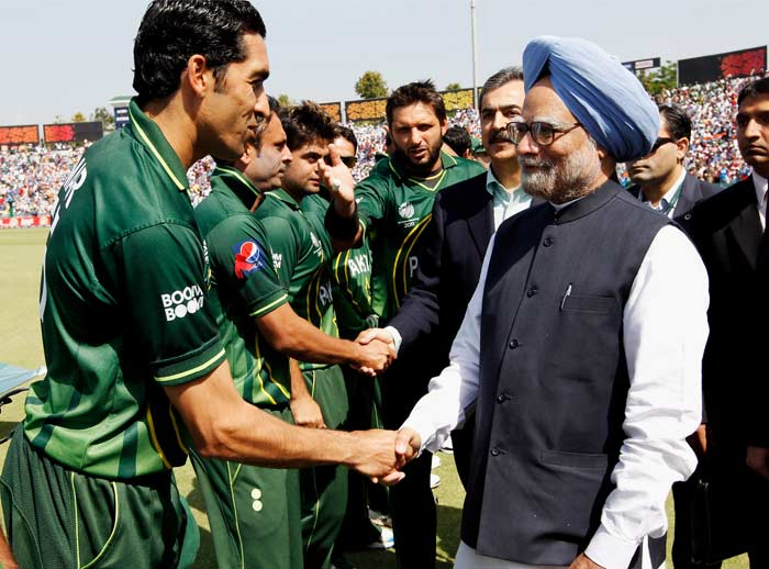 Pakistan's captain Shahid Afridi, background centre, introduces his players to Indian Prime Minister Manmohan Singh, and Pakistan Prime Minister Syed Yusuf Raza Gilani, background third right, prior to the start of the Cricket World Cup semifinal match between the arch rivals. (AP Photo)