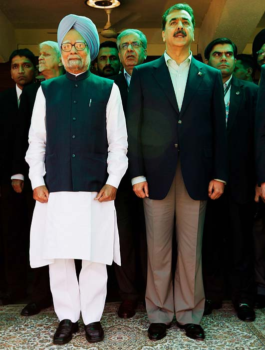 Indian Prime Minister Manmohan Singh and his Pakistani counterpart stand for the National Anthems of the neighbouring countries, prior to the start of the semi final encounter. (AP Photo)