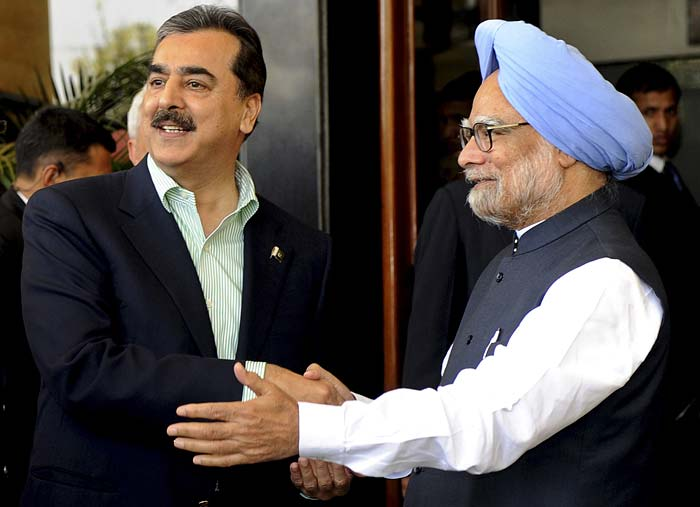 On the sidelines of the nail-biting match, Prime Minister Manmohan Singh also had a dinner meeting with his Pakistani counterpart Yousuf Raza Gilani. (AP Photo)