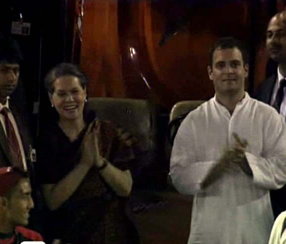 UPA chairperson Sonia Gandhi and son Rahul Gandhi cheer as team India defeat Pakistan by 29 runs in the semi final encounter of World Cup 2011.