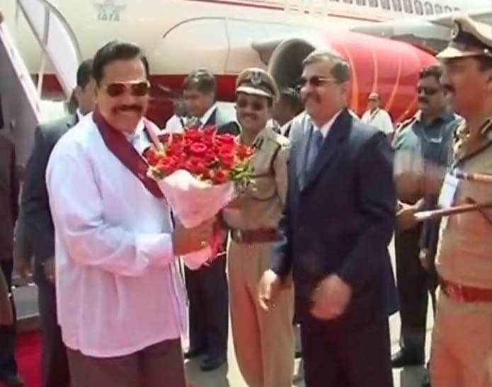 "Sri Lanka President Mahinda Rajapaksa landed in Mumbai for the India-Sri Lanka final. <br><br>""The President wants us (Sri Lanka) to win the World Cup as a tribute to Muttiah Muralitharan who retires from international cricket after this World Cup,"" Rajapaksa's spokesman had earlier said."