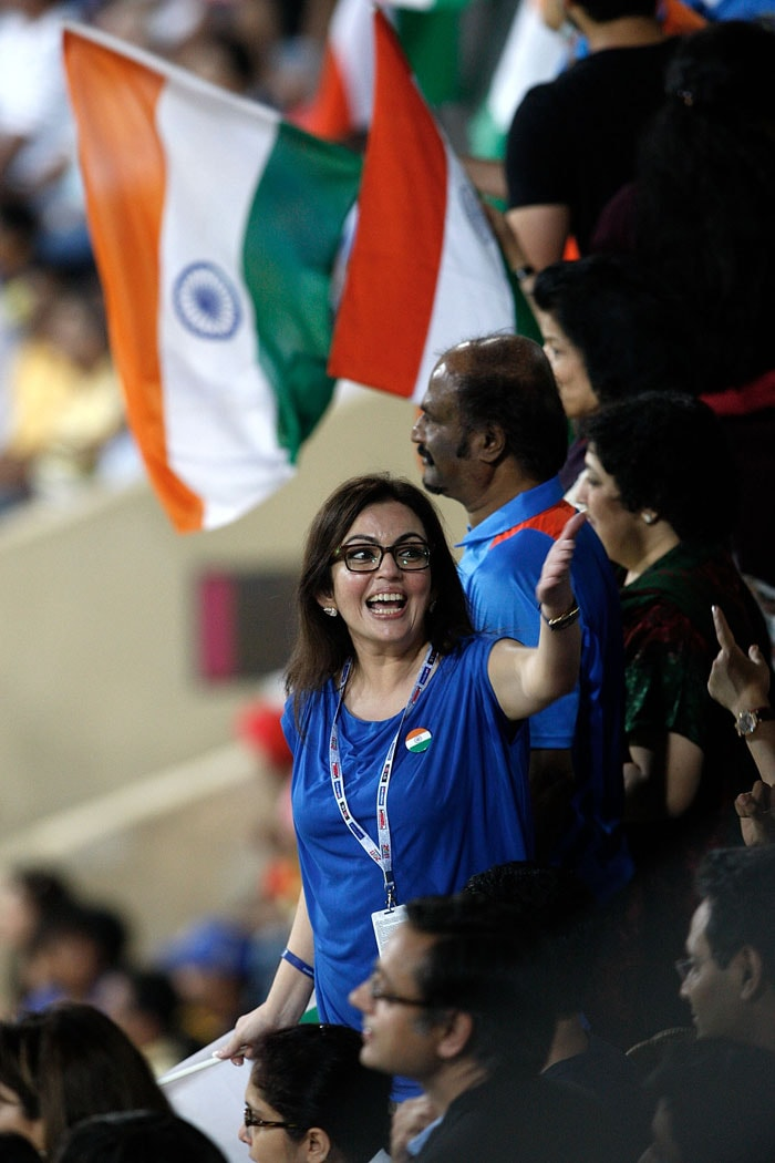 Nita Ambani is ecstatic as Rajinikanth looks calmly at the field. (Photo: Getty Images)