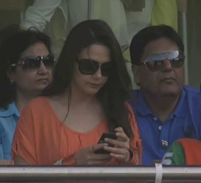 Preity messaging during the crucial match?
