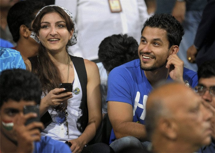 Soha and Kunal seem in high spirits as the game develops.<br>(Photo: PTI)
