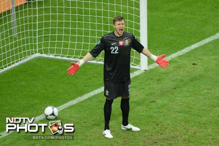Polish keeper Przeymslaw Tyton, who saved a penalty against Greece, had no answer to the glancing header.