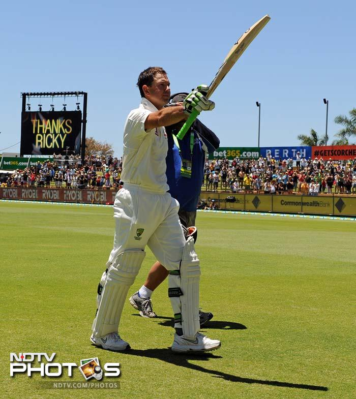 Ponting raises his bat after being dismissed by Robin Peterson for just 8. No, it was not an epic knock but the standing ovation from the spectators underlined the fact that it was a sparkling career.