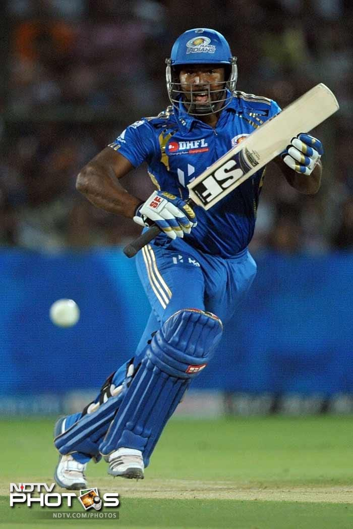 It was Dwayne Smith all the way for the Mumbai Indians as he smashed an unbeaten 87 runs and took the Rajasthan bowlers to the cleaners, smashing them all over the park. (PHOTOS AFP)