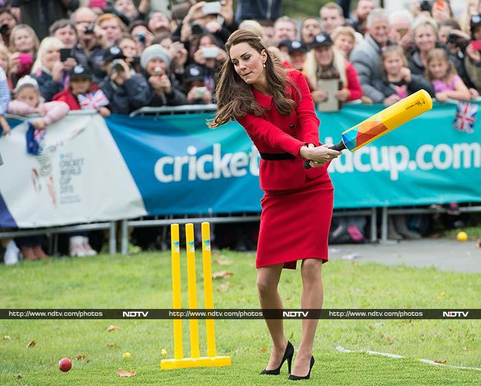 Not satisfied with just whacking the ball, Prince William took the ball to bowl to his wife. <br><br>Kate Middleton was not as aggressive but then again, the cricket pitch was no place to wear an otherwise stunning scarlet Luisa Spagnoli skirt suit and black heels.
