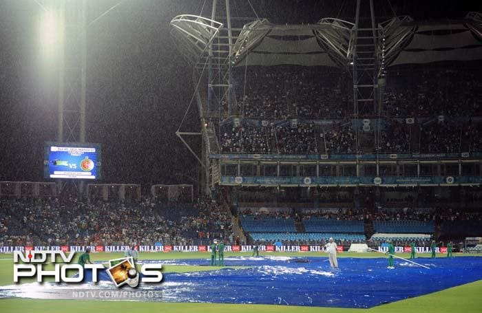 A burst of rain delayed the start of the match by an hour.