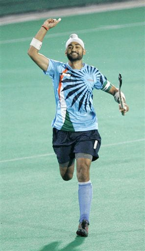 India's Sandeep Singh celebrates after scoring a goal against Netherlands during the four-nation hockey tournament final for the Punjab Gold Cup in Chandigarh on February 9, 2009.