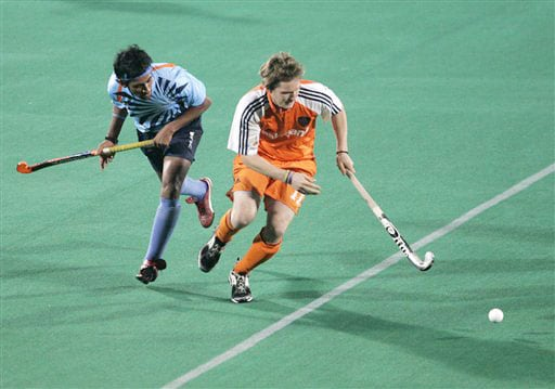 India's Arjun Halappa and Netherlands's Laurence Docherty vie for the ball during the four-nation hockey tournament final for the Punjab Gold Cup in Chandigarh.