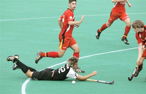 Germany's Linus Butt looks for the ball, as New Zealand's Nick Wilson loses his balance during the four-nation hockey tournament match for the Punjab Gold Cup in Chandigarh.