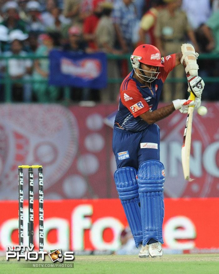 It was an easy victory in the end even though Delhi lost some quick wickets. Naman Ojha and Venugopal Rao cantered home to knock Kings XI Punjab out of the tournament. (AFP PHOTO/RAVEENDRAN)