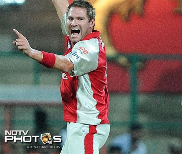 Ryan Harris did show some semblance of a fight when he got David Warner finally but he had already scored 79 off 44 balls to dismiss any hopes of the Kings XI Punjab to sneak into the qualifiers. (AFP PHOTO/RAVEENDRAN)