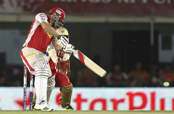 Swashbuckling 38-ball unbeaten century by David Miller kept Kings XI Punjab's hopes alive as the home side fashioned an unlikely 6-wicket win over Royal Challengers Bangalore in the 51st match of the Indian Premier League 2013, being played in Mohali. (BCCI Image)