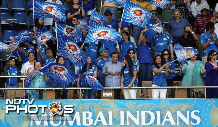 Indian industrialist and owner of Mumbai Indians team Mukesh Ambani watches the IPL Twenty20 match between Pune Warriors India and Mumbai Indians at the Wankhede Stadium in Mumbai. (AFP Photo/Indranil Mukherjee)