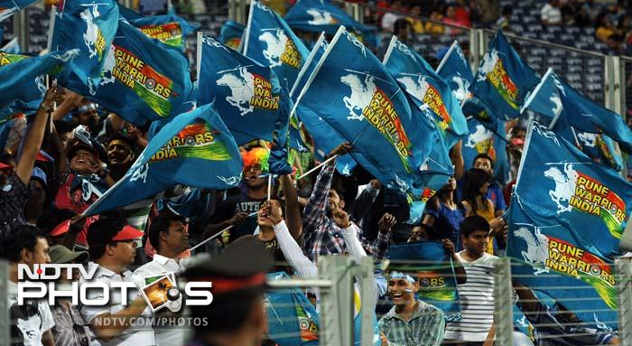 Pune Warriors supporters cheer their team before the start of the IPL Twenty20 cricket match against Chennai Super Kings at the Subrata Roy Sahara Stadium in Pune. (AFP PHOTO/Indranil MUKHERJEE)