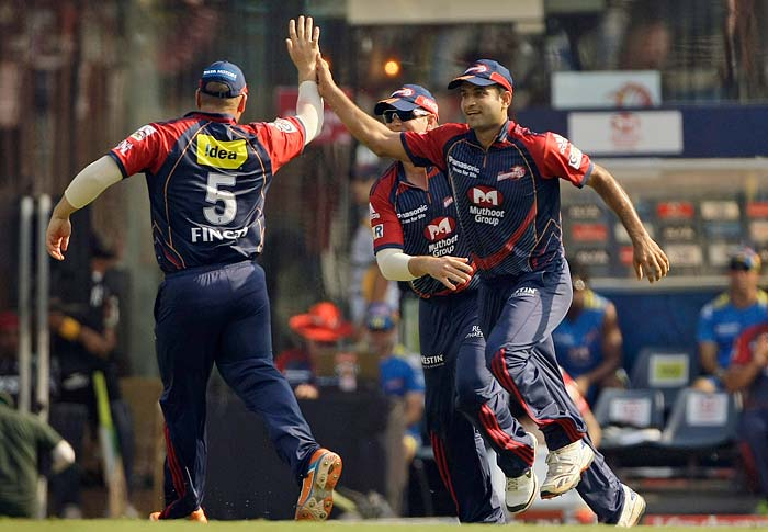Delhi Daredevils player Irfan Pathan, right, celebrates with teammates the wicket of Pune Warriors batsman Graeme Smith during their Indian Premier League (IPL) cricket match in Mumbai, India. (AP Photo)