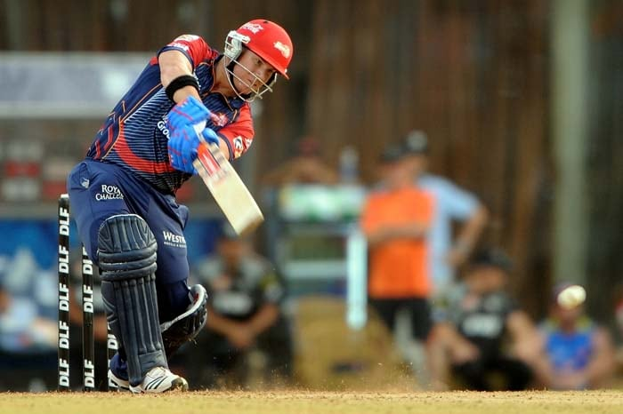 Delhi Daredevils opener David Warner plays a shot during the IPL Twenty20 match against Pune Warriors at the D.Y. Patil Cricket stadium on the outskirts of Mumbai. (AFP PHOTO)
