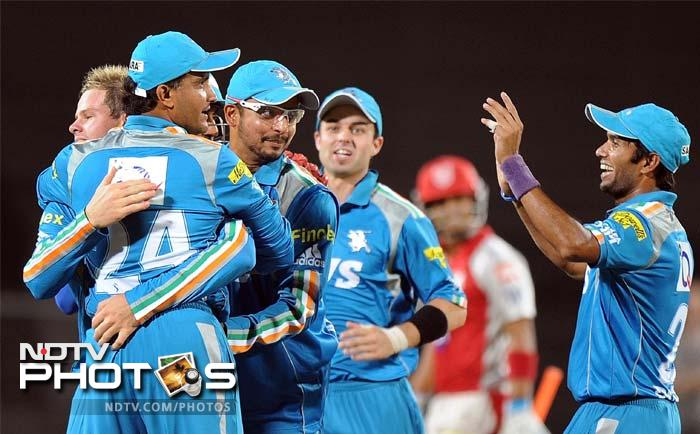 Pune Warriors India captain Sourav Ganguly (2nd L) celebrates with team mates after the wicket of Kings XI Punjab captain Adam Gilchrist during the IPL Twenty20 cricket match at the Subrata Roy Sahara Stadium in Pune. (AFP PHOTO/Punit PARANJPE)