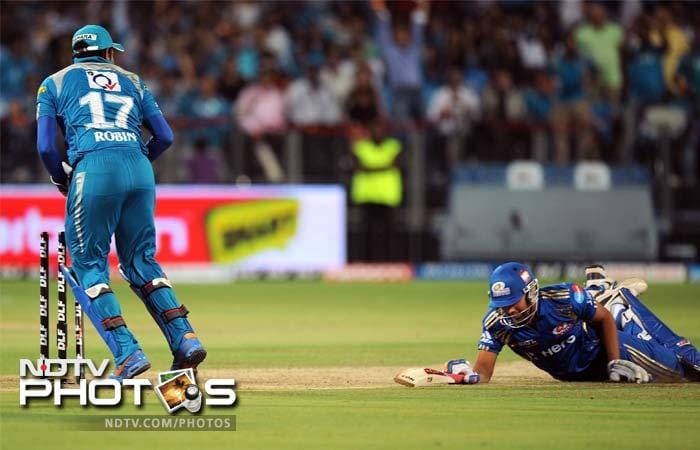 Rohit Sharma again failed to make an impression although he was the victim of a run out in this game. (AFP PHOTO/Indranil MUKHERJEE)