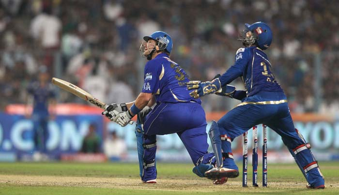 Almost immediately, Royals were dealt a body-blow with the 'turbanator' striking again to remove the dangerous Shane Watson, 6 off 8 balls. The Australian went trying a sweep and getting a top-edge. Mumbai skipper Rohit Sharma took an easy catch. (BCCI Image)