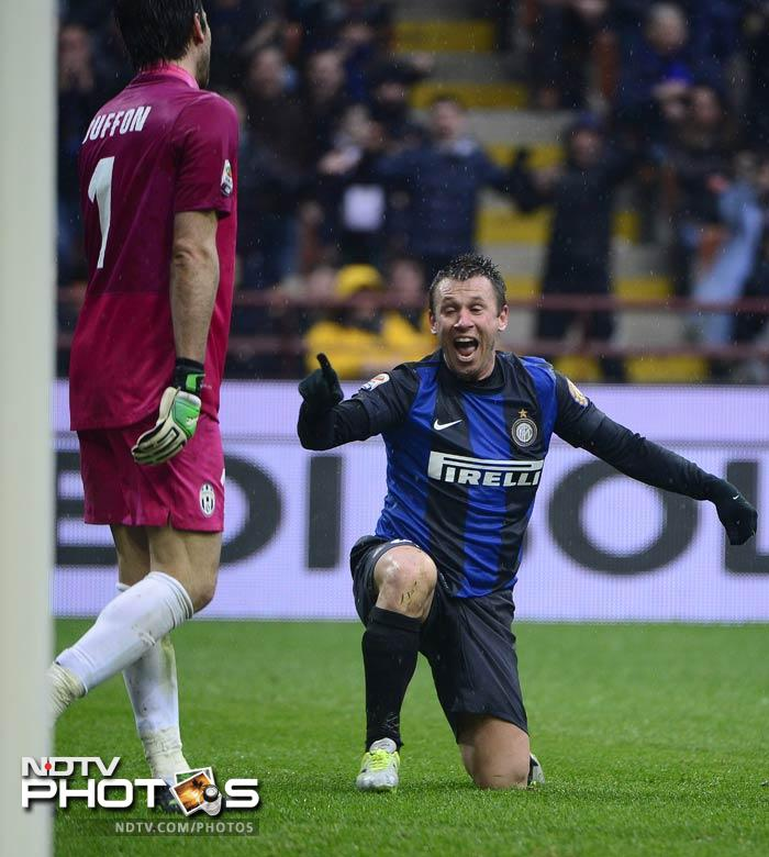 Italy teammates Antonio Cassano and Gigi Buffon engage in some banter during the Juventus-Inter Milan marque Serie A match on Saturday.