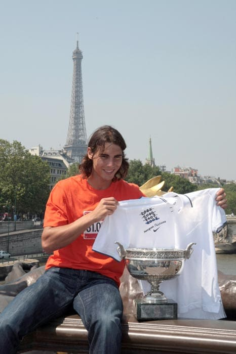 Rafael Nadal is seen posing on Alexander III's bridge in Paris, one day after winning the 2008 French tennis Open final match against Swiss Roger Federer.<br><br> Nadal, who won 6-1, 6-3, 6-0, took his place alongside Bjorn Borg as the only man to achieve four successive Roland Garros titles.