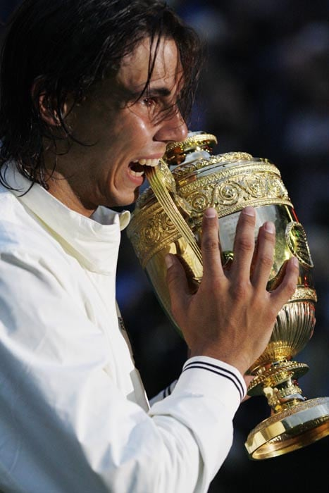 Nadal finally achieved the impossible when he defeated Roger Federer 6-4, 6-4, 6-7, 6-7, 9-7 in the final of the 2008 Wimbledon championships.<br><br> This was Federer's first defeat at Wimbledon after winning the coveted trophy for 5 continuous years since 2003.<br><br> This triumph gave Rafa the edge over Federer as he had now beaten him both on clay as well as grass and ensured that he was no more called a single surface champion.<br><br> He went on to take over as the world's top ranked tennis player from Federer the same year in August.