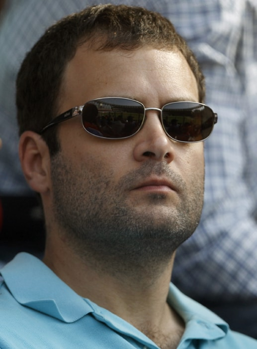 Rahul Gandhi opts for a blue t-shirt as against his trademark white <i>kurta</i>, showing his support for the Men in Blue.<br><br>As emotions ran high in the much-hyped final encounter, the young Gandhi managed to hide it behind his shades here.