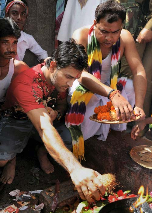 India captain Mahendra Singh Dhoni at the ancient Deori temple in Tamar, about 65 kms from Ranchi, soon after his return from the Australia tour. Dhoni is a regular visitor at this temple. (PTI Photo)