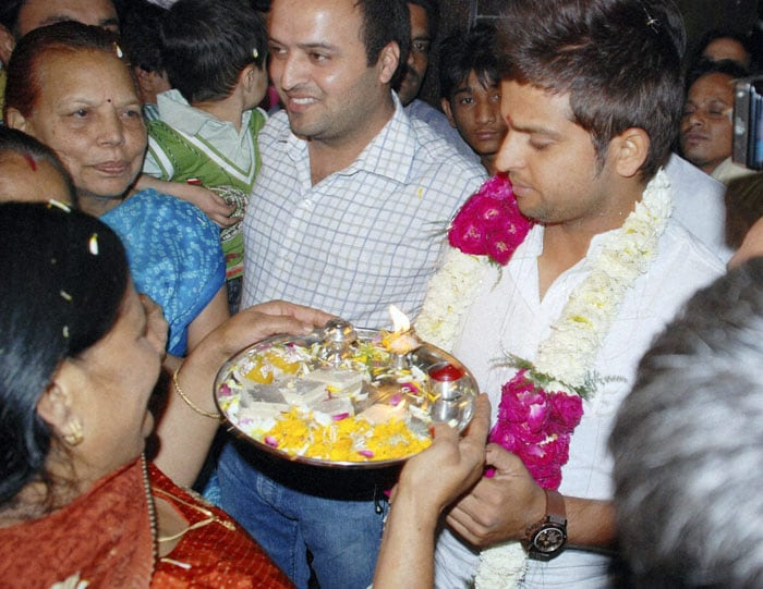 Raina who played a crucial role in the latter stage of the campaign got a warm welcome from his mother on his arrival at home in Gaziabad. (PTI Photo)