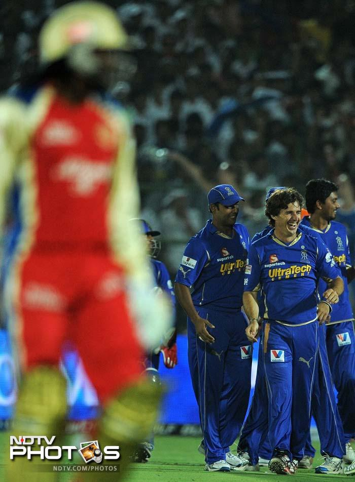 Brad Hogg rejoices the wicket of Chris Gayle (left). The Jamaican failed to get going and departed after scoring just 4 runs. (AFP PHOTO/ MANAN VATSYAYANA)