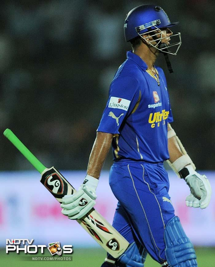 Dravid is seen walking back after he was dismissed on 58 off 42 balls, by KP Appanna. (AFP PHOTO/ MANAN VATSYAYANA)